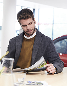Customer viewing an assortment of key service offers in a dealership or brochure